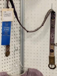 An ornately woven belt on display for the Iowa State Fair.